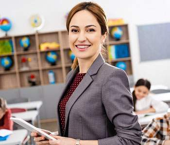 smiling teacher with digital tablet